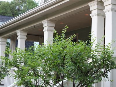 The Grand west facing front porch is a wonderful place to be embraced by nature.