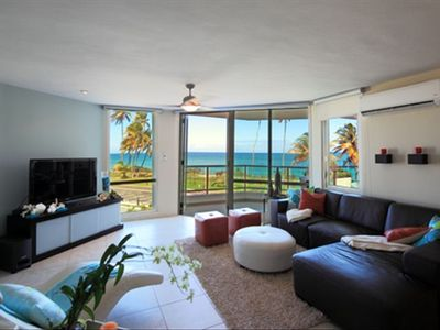 Living room opening to balcony and ocean views