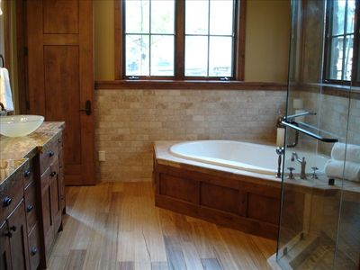 View of typical master bathroom with Jacuzzi tub.