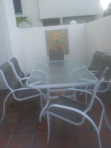 Palm Desert townhome rental - Back Patio Table and Chairs with Custom Wall Mosaic.