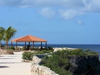 Curacao townhome photo - View sunsets and watch dolphins play from the beautifully landscaped coral bluff
