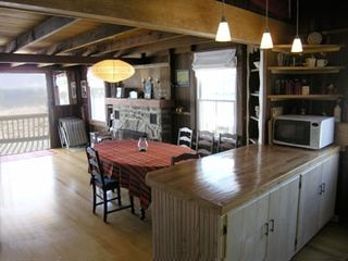 Old Lyme house photo - Open kitchen-dining area with french doors to deck