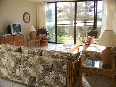 family room with one sofa bed, one other sofa, TV, and view of the golf course