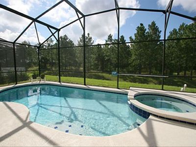 South facing pool with spa overlooking conservation area