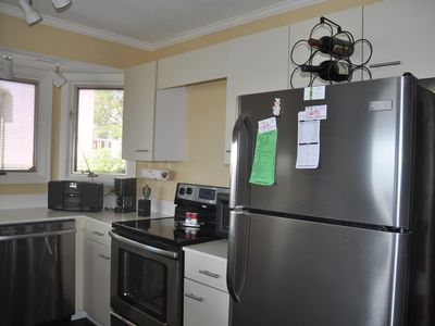 Kitchen with stainless appliances; Kitchen also has table/seating for 4