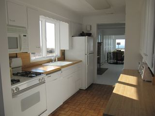 A bright, fully-equipped modern kitchen. - Peconic house vacation rental photo