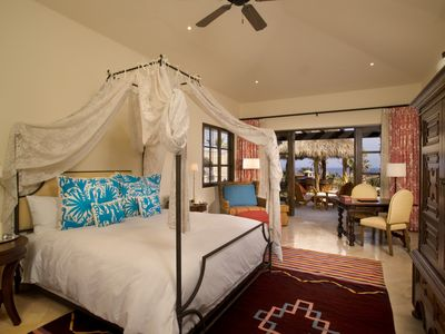 Canopy over king size bed just steps from patio and ocean views