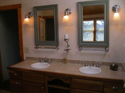 Double vanity/mirror with towel warmer in master bath