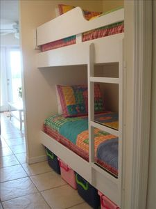 Awesome hall bunks w/ colorful rolling storage bins - great for kids or adults