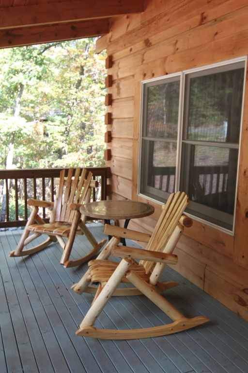 Enjoy the front porch with rustic log chairs