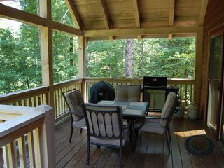 Cashiers house photo - Outdoor Covered Deck with Seating for four, with charcoal and propane grills