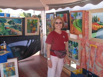 Carolyn at one of her art shows. Lots of original and purchased art in the house