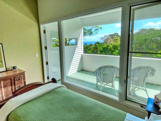 Pepeekeo house photo - Enjoy an ocean view from either bedroom or relax on the lanai outside your door