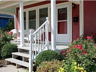 Muskegon house photo - Nostalgic open porch to catch the breezes, sip beverages, and chat up neighbors.