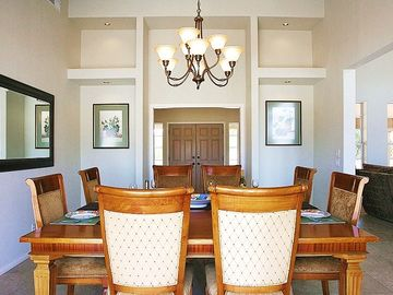 Elegant Dining Room in Main Residence for 8-12 Guests, with Entry Foyer Beyond.