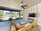 Patio - An outdoor living space on the ground-floor patio features a wicker sectional and 50
