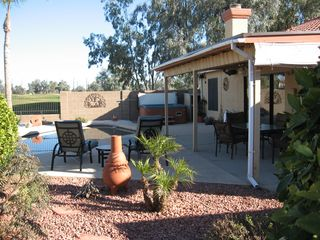 Glendale house photo - Comfortable seating under the covered patio. Table and chairs and 2 recliners.