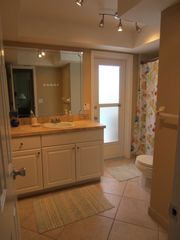 Vacation Homes in Marco Island house photo - Bathroom with door that leads out to Pool