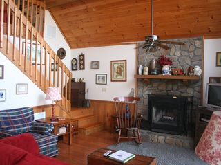 Bryson City chalet photo - Snuggly great room with wood-burning fireplace