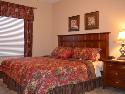 Master Bedroom - King Bed, luxury sheets, designer bedding set, & ceiling fan.