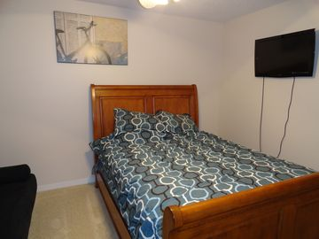"2nd Bedroom has Queen Sleigh Bed with 32"" LED TV and adjustable Futon"