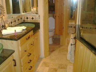 Walker cabin photo - Looking into the masterbath with double sinks and heated floors.