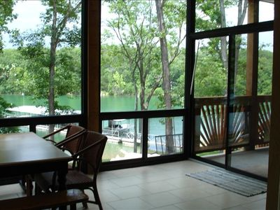 Eating and game table with seating for up to 12, view of the lake rain or shine.