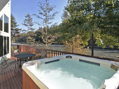 Relax in the hot tub & enjoy the River view