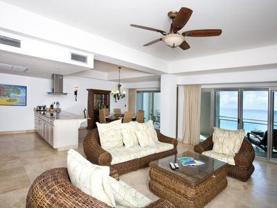 Overview of living area with oceanfront patio access