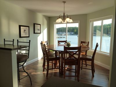 Beautiful eat-in kitchen. Seating for 6 around the table. Plus 7 more at the bar