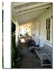 Los Angeles house photo - Front porch w/ bench, 2 Adirondack chairs, table & lamp