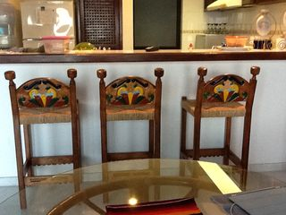 New hand-carved bar stools. - Bucerias townhome vacation rental photo