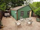Welcome to your private, fenced garden cottage with outdoor dining and seating.