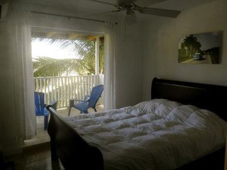 Isabela apartment photo - Lovely comfortable bedroom with antiques balcony with ocean views