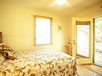 Bedroom 1 with french door leading to private yard..