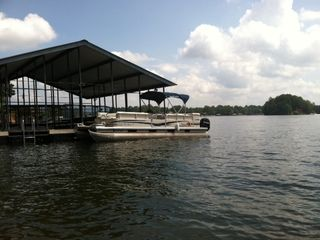 Our onsite party barge rental moored to our boat dock.