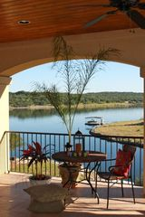 Lago Vista house photo - Upstairs Veranda Overlooking Lake Travis to enjoy your coffee in the morning.