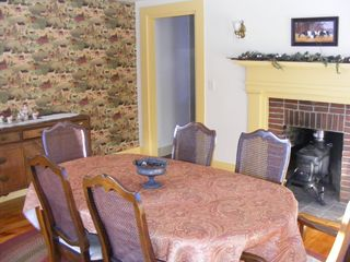Alton farmhouse photo - Share family meals in the dining room with tons of room for the entire family.