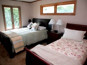 One of two bedrooms with queen and single