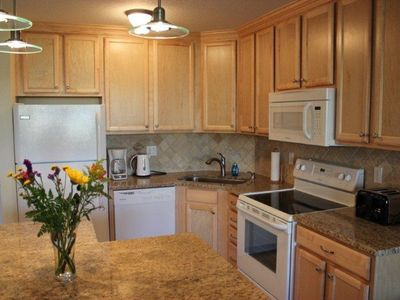 Luxury kitchen with granite counter tops and brand new appliances