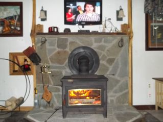 Moultonborough cottage photo - wood stove/ with glass fire veiw and lcd tv above to relax by