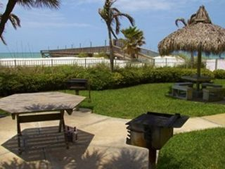 Redington Shores condo photo - Tables and BBQ grills