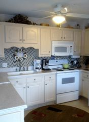 Remodeled kitchen! NEW cabinets, dishwasher, micro, glass tile, Corian Counters! - Myrtle Beach Resort condo vacation rental photo