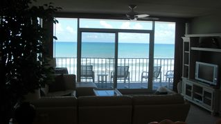 New Smyrna Beach condo photo - Living Room Sectional Looking out on the ocean