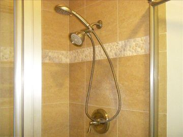 Beach pebble detail in master shower. Nice! Clean!