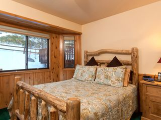Bear Mountain cabin photo - 3rd bedroom Log style queen bed with LCD Flatscreen on wall.
