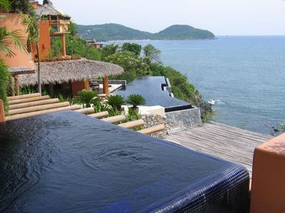 Private dip pool overlooks 20-meter infinity lap pool and the Pacific Ocean