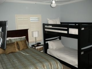 Gulf Shores condo photo - Second bedroom with Queen bed, twin over twin bunk beds, flat screen TV