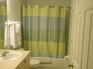 Windsor Palms house photo - 3rd full bathroom - upstairs - tub with shower, curved shower rail, hair dryer