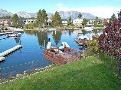 Fenced back lawn, over-water deck and private boat dock.